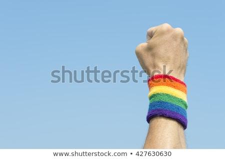 Mann Regenbogen Flagge Homosexuell Stolz Beziehungen Stock foto © dolgachov