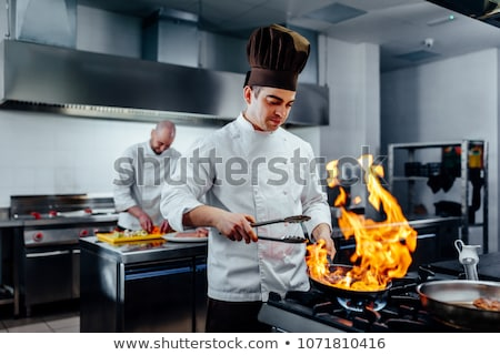 happy male chef cooking at restaurant kitchen Stock photo © dolgachov