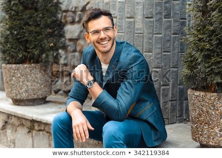 portré · fókuszált · koncentrált · férfi · öltöny · napszemüveg - stock fotó © feedough