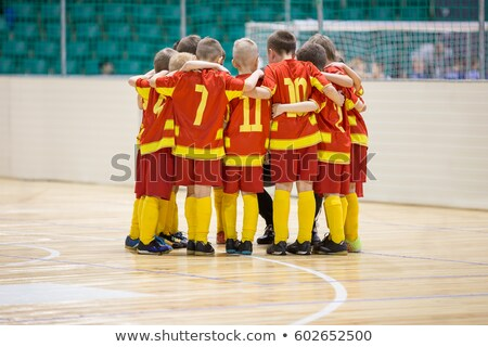 Kids Futsal Indoor Soccer Team Standing Together with Coaches Stock photo © matimix