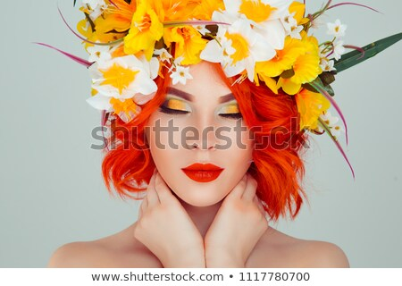 Redhead Woman with Narcissus or Daffodil Flower Stok fotoğraf © robuart