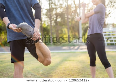Early morning workout, Fitness couple stretching outdoors in par Photo stock © snowing