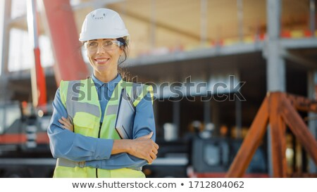 Mosolyog női beszállító védősisak építkezés ház Stock fotó © feverpitch