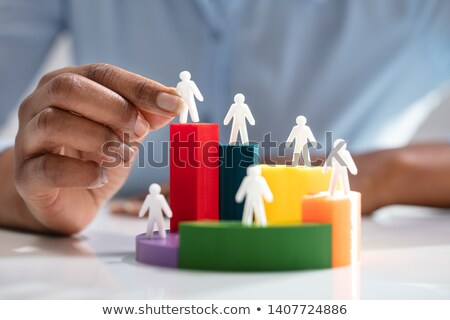 businesswoman placing human figures on 3d pie chart stock photo © andreypopov