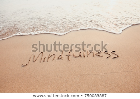Mindfulness Written Text On Sand At Beach Stock photo © AndreyPopov