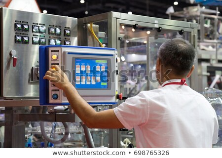Сток-фото: мужчины · оператор · кнопки · панель · управления · красивый · контроль