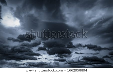 Sky background with rain and gray clouds Stock photo © colematt