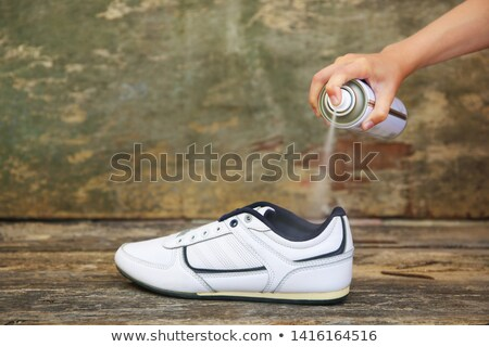 Human Spraying Deodorant On Shoes Stock photo © AndreyPopov