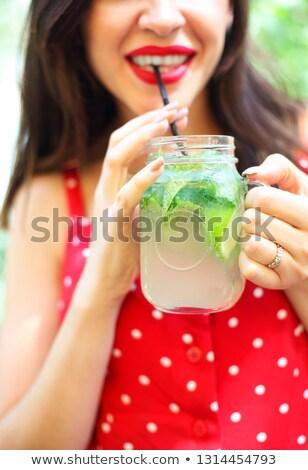 Jonge brunette vrouw metselaar jar Stockfoto © dashapetrenko