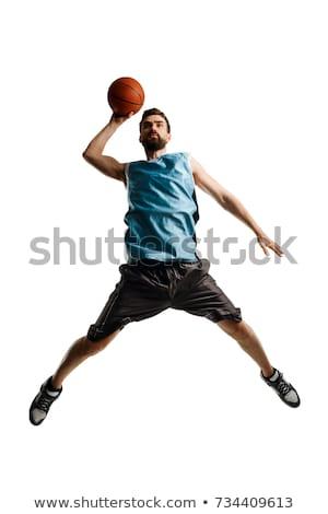 Labda lábak fiatal profi kosárlabdázó áll Stock fotó © pressmaster