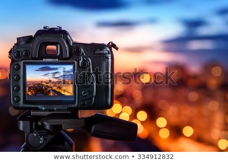 photographer with digital camera photo and tripod stock photo © robuart