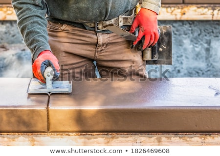 Construction Worker Using Hand Groover On Wet Cement Forming Cop Stock photo © feverpitch