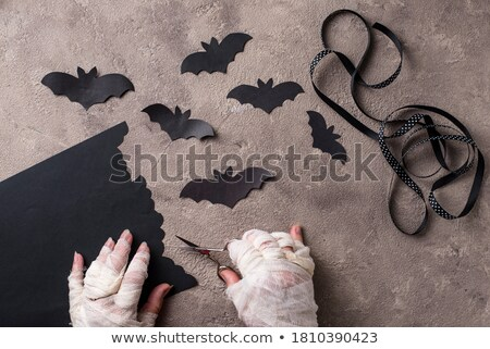 Mummy makes bats out of paper Stock photo © furmanphoto
