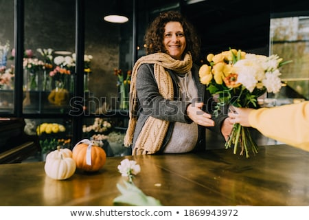 Florist waiting for customer in flower shop Stock photo © pressmaster