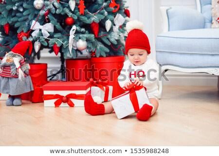 Little girl unpacking christmas gift at Christmas decoration Stock photo © dashapetrenko
