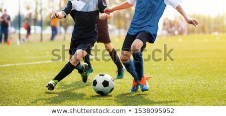 Piłkarz uruchomiony piłka zielone dziedzinie stadion Zdjęcia stock © jossdiim