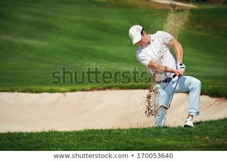 Maschio golfista giocare sabbia pericolo senior Foto d'archivio © lichtmeister
