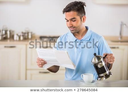 午前 · ニュース · ハンサム · 若い男 · 飲料 · コーヒー - ストックフォト © ruslanshramko