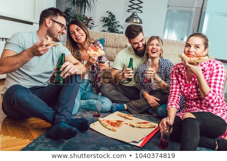 happy friends with drinks and pizza party at home Stock photo © dolgachov