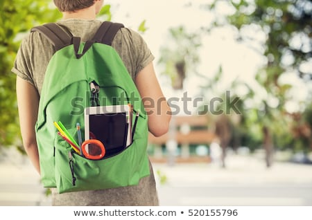young man or student with school bag or backpack Stock photo © dolgachov
