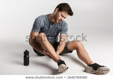устал молодые спортсмен полу изолированный Сток-фото © deandrobot