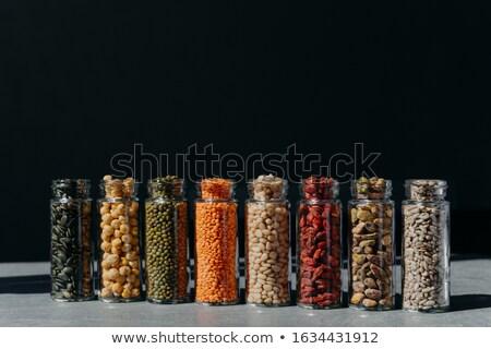 üveg bögre nyers magvak izolált sötét Stock fotó © vkstudio