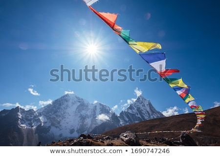 Prayer flags of Tibetan Buddhism with Buddhist mantra on it in Dharamshala monastery temple. India Stock photo © dmitry_rukhlenko