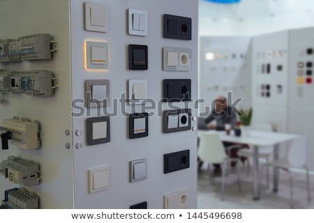 Electrician with a light switch Stock photo © photography33