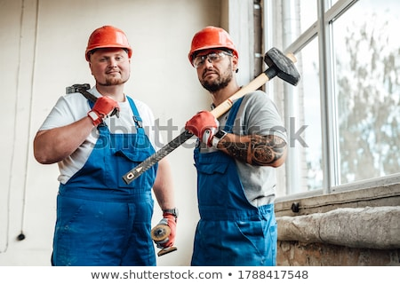 A construction worker with a sledgehammer. Stock photo © photography33