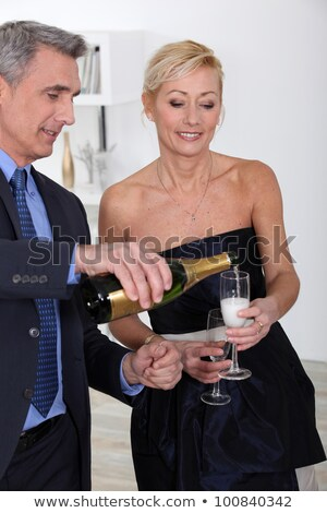 two 50's old people drinking sparkling wine Stock photo © photography33