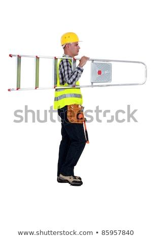 handyman or worker carrying metallic ladder stock photo © lightkeeper