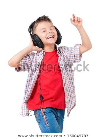 jonge · kind · luisteren · naar · muziek · lachend · geïsoleerd - stockfoto © gewoldi