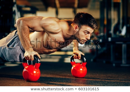 handsome fit shirtless man doing pushups stock photo © stockyimages