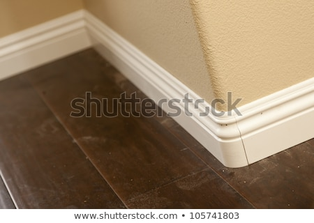New Baseboard and Bull Nose Corners with Laminate Flooring Stock photo © feverpitch