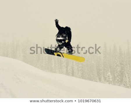 Snowboarder catching some air Stock photo © photography33