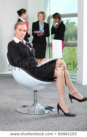 Woman sat on office chair Stock photo © photography33