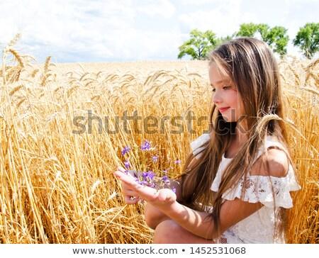 девушки цветы девочку красные цветы глядя Сток-фото © silent47