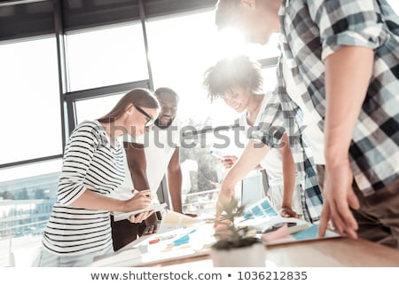 creative team working around a laptop stock photo © photography33
