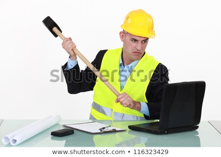 Laborer destroying computer with hammer Stock photo © photography33