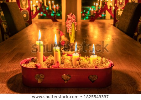 pink santa claus in dark with candle Stock photo © carlodapino