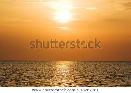 Naranja puesta de sol tranquilo sereno playa Foto stock © acidgrey