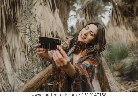 Woman taking selfpicture Stock photo © Ronen