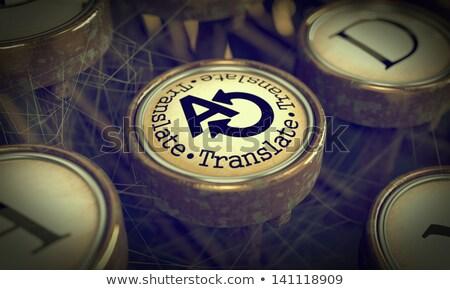 translate typewriter key grunge background stock photo © tashatuvango