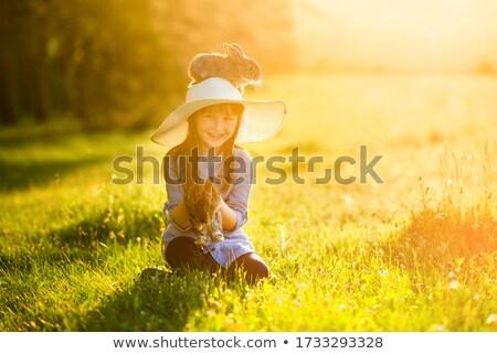 little girl holding her head stock photo © tarikvision