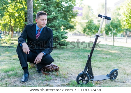 casual man crouched in the grass  Stock photo © feedough