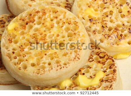 Pile of hot crumpets with melted butter Stock photo © raphotos