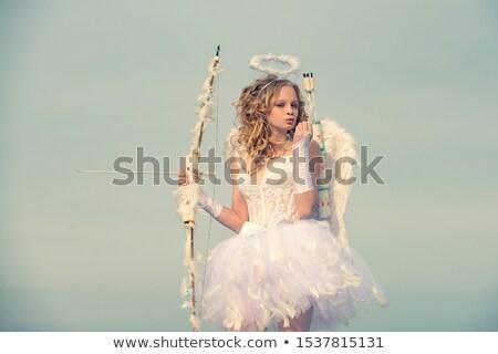 Boldog tini lány íj nyíl ünnepek Stock fotó © dolgachov