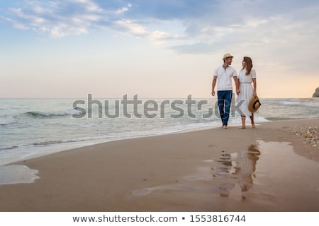 walking along the beach stock photo © komar