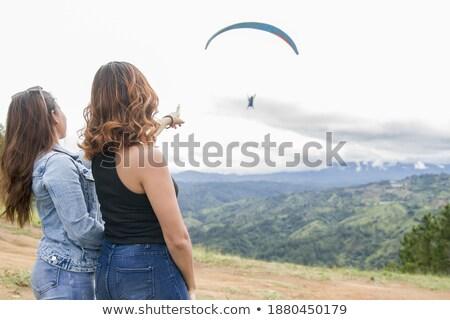 Woman Points To Distant Mountain Stock photo © pancaketom