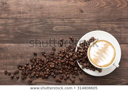 新鮮な 芳香族の コーヒー豆 木製 カップ クローズアップ ストックフォト © OleksandrO